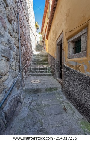 Porto, Portugal. December 29, 2014: The typical very narrow and steep medieval street of the older parts of the city, connecting the Cathedral zone to the Ribeira District. Unesco World Heritage Site - stock photo
