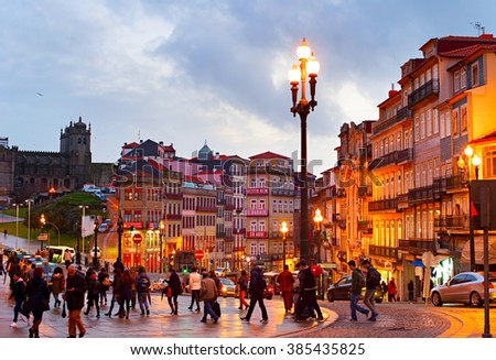 PORTO, PORTUGAL - JAN 15, 2015: People walking on the Old Town street of Porto. Porto historical core was proclaimed a World Heritage Site by UNESCO in 1996 - stock photo