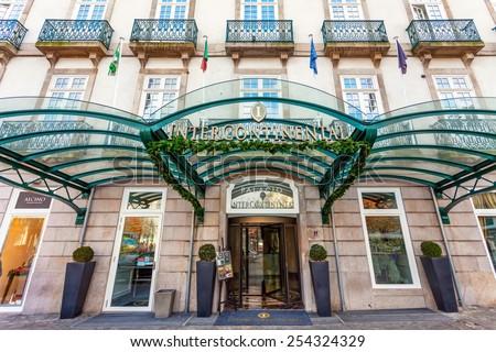 Porto, Portugal. January 5, 2015: Entrance of the Palacio das Cardosas Intercontinental Hotel facing the Aliados Avenue and Liberdade Square. A five stars hotel. - stock photo