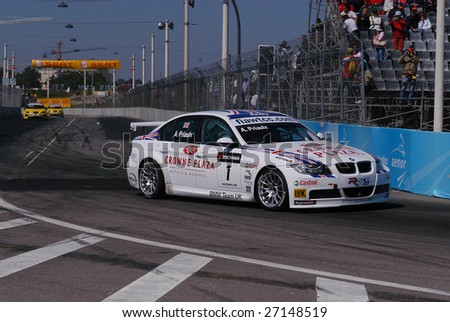 PORTO, PORTUGAL - JULY 8: Andy Priaulx of UK in his BMW participates in the FIA WORLD TOURING CAR CHAMPIONSHIP (WTCC) on July 8, 2007 in Porto, Portugal. Priaulx emerged 2007 WTCC Drivers' Champion. - stock photo