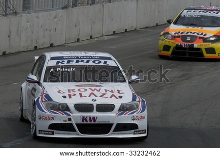 PORTO, PORTUGAL - JULY 6: ANDY PRIAULX of UK in his BMW team UK participates in the FIA WORLD TOURING CAR CHAMPIONSHIP on July 6, 2009 in Porto, Portugal. - stock photo