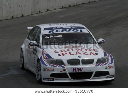 PORTO, PORTUGAL - JULY 5: ANDY PRIAULX of UK in his BMW team UK participates in the FIA WORLD TOURING CAR CHAMPIONSHIP on July 5, 2009 in Porto, Portugal - stock photo