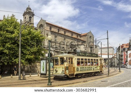 PORTO, PORTUGAL - JULY 04, 2015: Famous Heritage yellow tram, called Electrico in the center of Porto, On July 04, 2015 in Porto, Portugal.