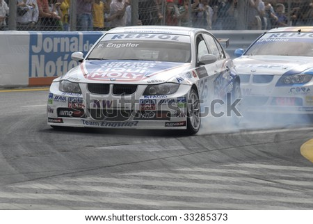 PORTO, PORTUGAL - JULY 5: FRANZ ENGSTLER of A in his BMW team Liqui Moly Team participates in the FIA WORLD TOURING CAR CHAMPIONSHIP on July 5, 2009 in Porto, Portugal. - stock photo