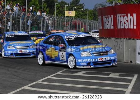 PORTO, PORTUGAL - JULY 8: R.Huff of ITA in his Chevrolet Lacetti participates in the FIA WORLD TOURING CAR CHAMPIONSHIP  on July 8, 2007 in Porto, Portugal. - stock photo