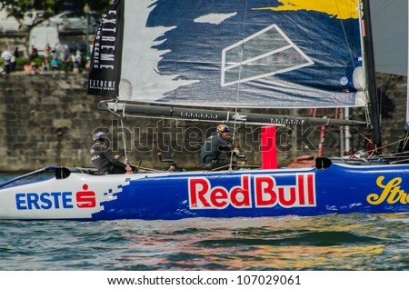 PORTO, PORTUGAL - JULY 07: Red Bull Sailing Team compete in the Extreme Sailing Series boat race on july 07, 2012 in Porto, Portugal. - stock photo