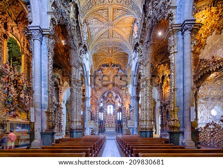 PORTO, PORTUGAL - JULY 9: Symmetrical composition of rich decorated interior of church museum of saint francis , on July 9, 2014 in Porto, Portugal. - stock photo