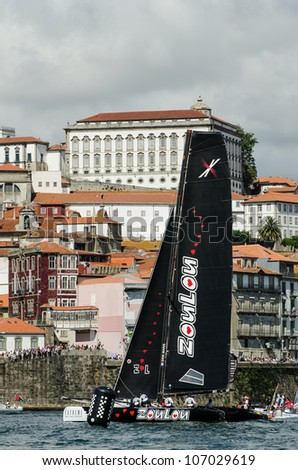 PORTO, PORTUGAL - JULY 07: ZouLou compete in the Extreme Sailing Series boat race on july 07, 2012 in Porto, Portugal.