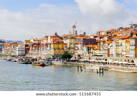 PORTO, PORTUGAL - JUN 21, 2014: Colour houses on the bank of the river Douro, one of the major rivers of the Iberian Peninsula (2157 m)
