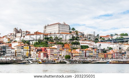 PORTO, PORTUGAL - JUN 21, 2014:  Ribeira quarter, Valley Douro, traditional sight, UNESCO World Heriatge site. View from the River Douro, one of the major rivers of the Iberian Peninsula (2157 m)