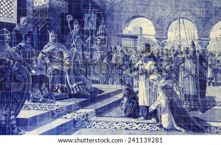 PORTO, PORTUGAL - JUNE 4, 2014: Azulejo panel in the Sao Bento Railway Station in Porto, Portugal. This panel was created around 1900 and depicts the meeting of the knight Egas Moniz and Alfonso VII. - stock photo