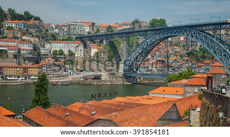 PORTO, PORTUGAL - 25 JUNE, 2010: Old town cityscape on the Douro River with traditional Rabelo boats in Porto, Portugal.