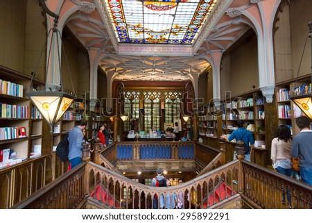 PORTO, PORTUGAL - JUNE, 12: People visit famous bookstore Livraria Lello on June 12, 2015 in Porto, Portugal - stock photo
