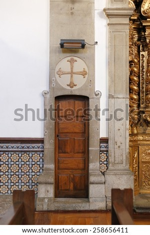 Porto, Portugal - March 4, 2015: One of the interior lateral door of the old St. Nicholas church. Church from XVII century, rebuilt in the eighteenth century. Neoclassical and baroque style.