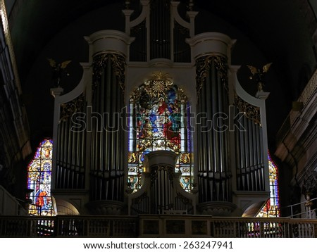 Porto, Portugal - March 23, 2015: Stained glass windows from Lapa church behind the pipe organ in the choir - stock photo