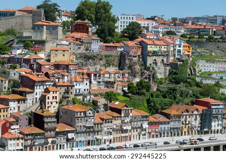 PORTO, PORTUGAL - MAY 17, 2015: Multicolored buildings on the hills