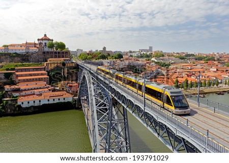Porto, Portugal - May 15, 2014: Upper deck of the old bridge D. Luis seeing the surface metro and part of the old town of Vila Nova de Gaia, Porto twin city, with their famous Port wine cellars