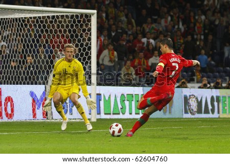 PORTO, PORTUGAL - OCTOBER 8: Cristiano Ronaldo (POR) about to score Portugal's 3rd goal on the Euro2012 Qualifying match against Denmark on October 8, 2010 in Porto, Portugal - stock photo