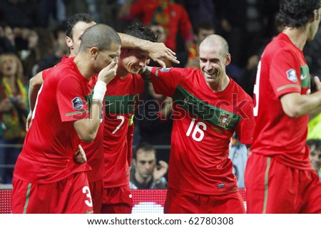 PORTO, PORTUGAL - OCTOBER 8: Cristiano Ronaldo (POR) celebrates with his companions Portugal's 3rd goal in Euro 2012 Group Stage Qualifying match against Denmark on October 8, 2010 in Porto, Portugal - stock photo