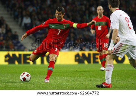 PORTO, PORTUGAL - OCTOBER 8: Cristiano Ronaldo (POR) (L) prepares to shoot the ball near William Kvist (DEN) in the Euro 2012 Qualifying match against Denmark on October 8, 2010 in Porto, Portugal - stock photo