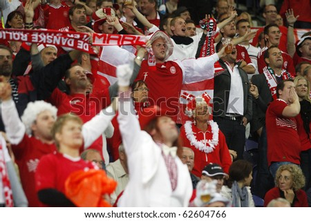 PORTO, PORTUGAL - OCTOBER 8: Danish (Dane) supporters encourage their National Team in the Euro 2012 Group Stage Qualifying match against Denmark on October 8, 2010 in Porto, Portugal - stock photo