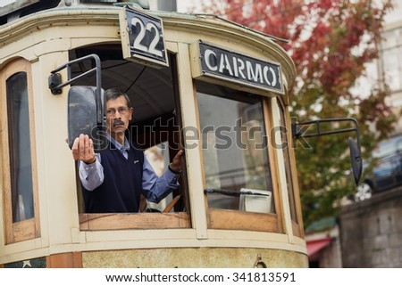 PORTO, PORTUGAL - OCTOBER 19, 2015: Driver of Famous old tram on street of Porto. Trams operating in Porto since 1872 - stock photo