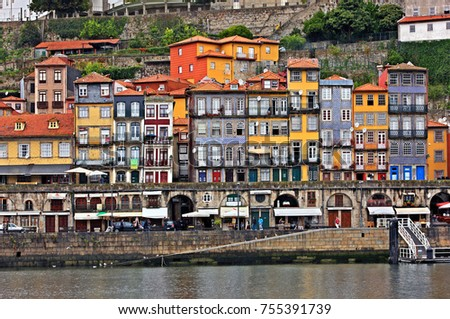 "PORTO, PORTUGAL- October 11, 2015. Facades at the Ribeira, the most beautiful neighborhood of the city. Some of the facades are decorated with traditional ceramic tiles called ""azulejos""."
