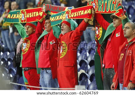 PORTO, PORTUGAL - OCTOBER 8: Portuguese supporters singing their country's National Anthem in the Euro 2012 Group Stage Qualifying match against Denmark on October 8, 2010 in Porto, Portugal - stock photo
