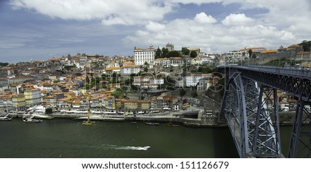 Porto Portugal on Douro river with Luis I bridge on right side  - stock photo