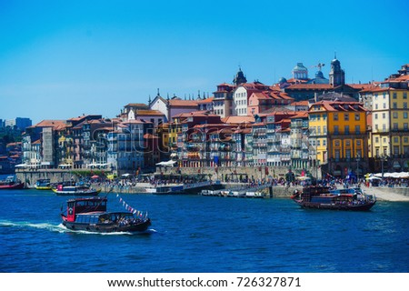 PORTO, PORTUGAL - SEPTEMBER 5, 2017: Douro river and Ribeira river walk with tourists and rabelo boats view