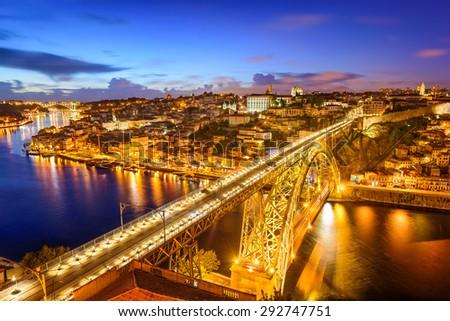 Porto, Portugal Skyline over Dom Luis I Bridge and Douro River. - stock photo