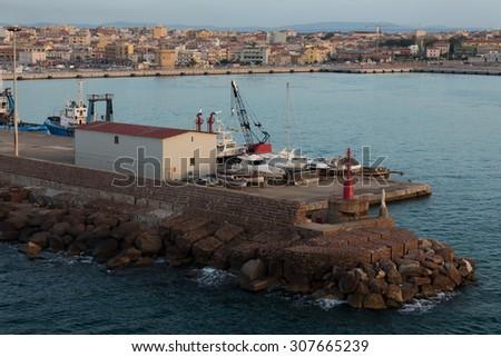 porto torres harbor in evening time - stock photo
