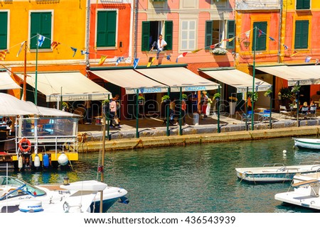 PORTOFINO, ITALY - MAY 4, 2016: Boats in Portofino, an Italian fishing village, Genoa province, Italy. A vacation resort with a picturesque harbour and with celebrity and artistic visitors.