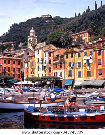 PORTOFINO, ITALY - SEPTEMBER 19, 1996 - Traditional fishing boats in the harbour with the town to the rear, Portofino, Liguria, Italy, Western Europe, September 19, 1996.