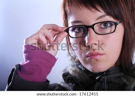 Portrai of a young woman wearing glasses - stock photo