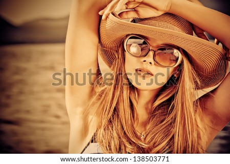 Portrair of a beautiful young woman over seascape. - stock photo