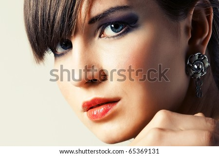 Portrait a beautiful young woman with decorative make-up - stock photo