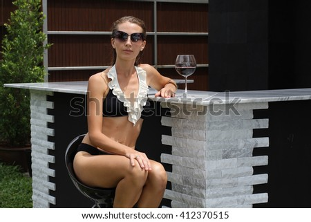 Portrait a close up of the female young client drinking red wine - stock photo