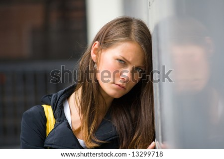 Portrait a young woman in city. - stock photo