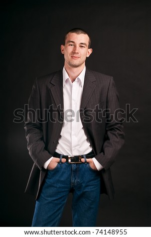 Portrait adult businessman on a black background