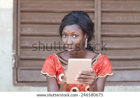 Portrait African Black Girl Studying Working With iPad Computer Technology - stock photo