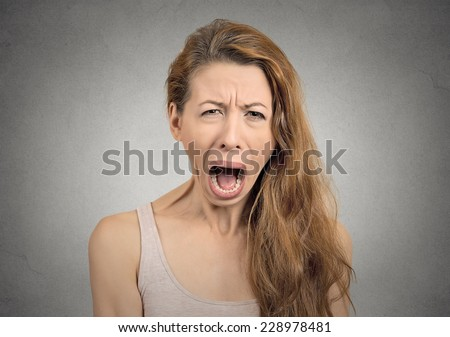 Portrait angry upset woman screaming crying wide open mouth hysterical face grimace isolated grey wall background.Negative human expression emotion bad feeling reaction. Conflict confrontation concept - stock photo
