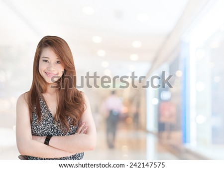 portrait asian businesswoman with long hair has shopping mall background.Mixed Asian / Caucasian businesswoman.