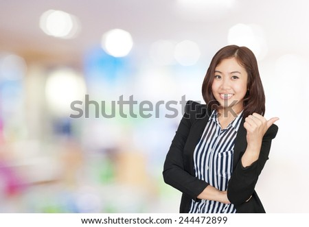portrait asian businesswoman 20 -30 year old with long hair has shopping mall background.Positive emotion - stock photo