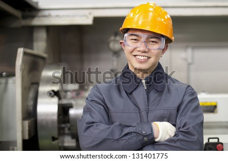 Portrait asian engineer in factory - stock photo