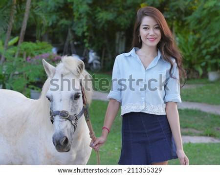 Portrait asian girl and white horse.