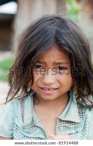 portrait asian girl, child in dirty condition show their poverty