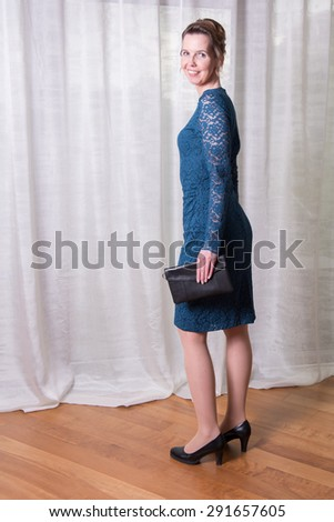 Portrait attractive woman in blue dress - stock photo