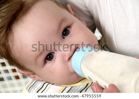 Portrait baby drinking milk of her bottle