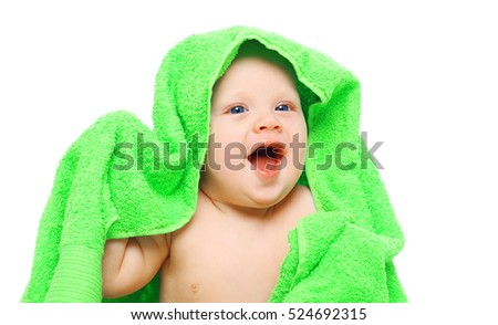 Portrait baby under towel on a white background